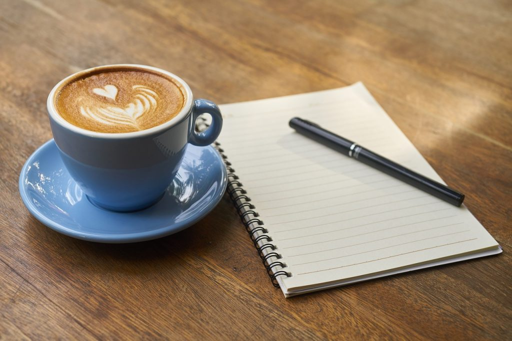 coffee, pen, notebook